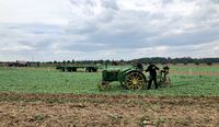 Children learn how to use an old tractor and plow during the World Ploughing Competition in Germany 2018