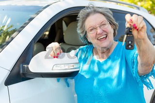 Happy Senior Woman With New Car and Keys