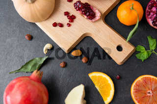 different vegetables and fruits on on slate table