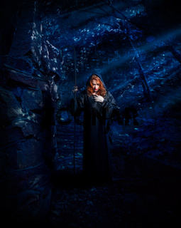 Witch in the ruins in night forest