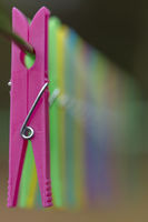 Colored clothespins in blur