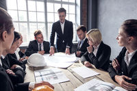 Business people discussing construction projects