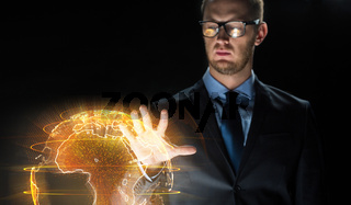 close up of businessman with earth hologram