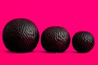Decorative Black Sphere with Irregular Spiral Pattern on Pink
