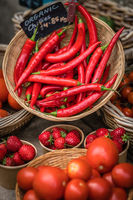 Chillies, strawberries and tomatoes for sale