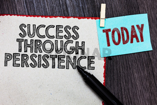 Writing note showing Success Through Persistence. Business photo showcasing never give up in order to reach achieve dreams White page red borders marker clothespin reminder wooden background.