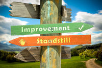Street Sign to Improvement versus Standstill