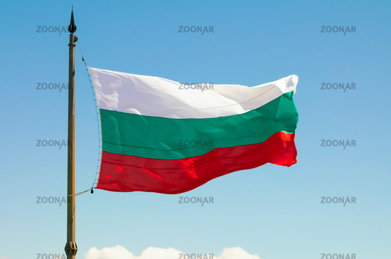 The Bulgarian Flag over the Memorial of Liberty Shipka, Gabrovo, Bulgaria. The national flag of Bulgaria against the background of the blue sky.
