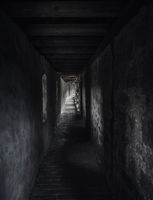 Ancient corridor with beams of light. Dark hallway in a medieval building.