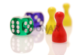 Gambling dices and wooden figures isolated on white background. Games, entertainment and luck concept.