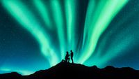 Northern lights and silhouettes of a couple