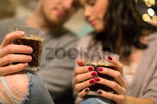 close up of happy couple drinking coffee at home