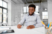 african american businessman with papers at office