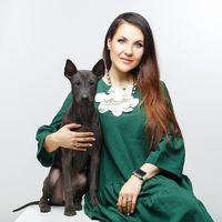 woman with thai ridgeback puppy