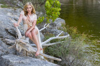 A Lovely Blonde Model Enjoys A Day At The Lake