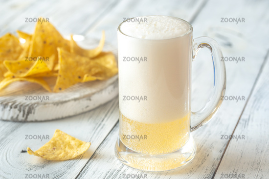 Mug of beer with tortilla chips