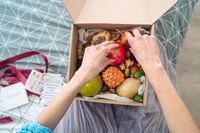 Box of fruit girl hands