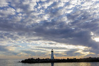 Cloudy sunset over Breakwater (Walton) Lighthouse as seen from Seabright Beach.