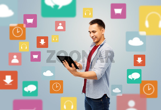 happy young man with tablet over media icons