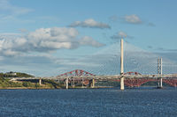 The new Queensferry Crossing bridge over the Firth of Forth with the older Forth Road bridge and the iconic Forth Rail Bridge in Edinburgh Scotland.