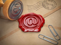 E-mail sign sealing wax stamp.  Internet communication concept.