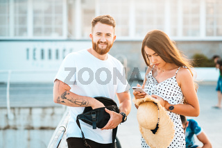 Handsome bearded man and his beautiful girl posing at camera