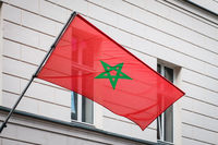 moroccan flag on pole on building - morocco flag -