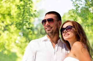 happy smiling couple in sunglasses
