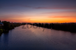 Nepean River glowing with reds and blues at sunset