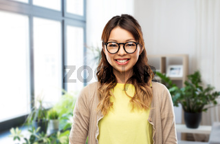 happy asian woman in glasses at home