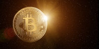 Bitcoin in space with rising sun behind