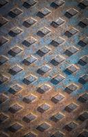 Closeup of a rusty manhole cover