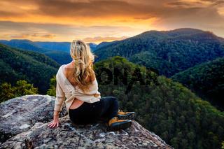Woman mountain gazing at sunset