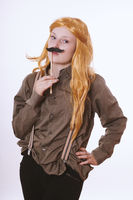 young woman dressed up as a man with fake moustache