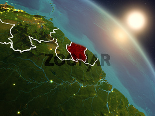Suriname from space during sunrise