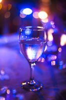 Wineglass outdoors on table by night