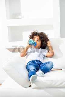 Young afro child on the couch