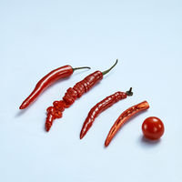 Collage of chili peppers and tomato on gray background
