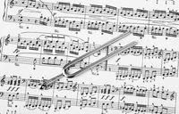 Pitchfork on sheet music - art background