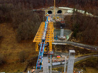 Aerial of a complex new railway bridge construction between two tunnels