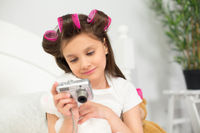 Girl playing with camera.