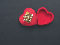Heart shaped gift box with a golden bow