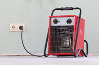 Compact red heater, drying the floor
