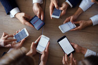Businesspeople hands using phone