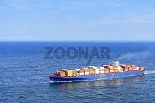 Cargo ship over the sea