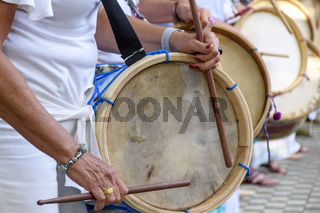 Woman drum player hands and instrument