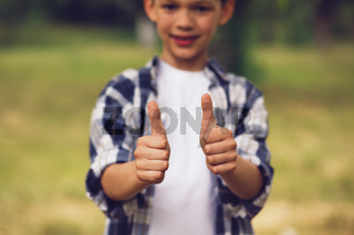 Little boy showing thumbs up.
