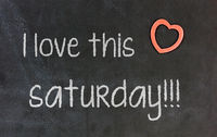Blackboard with small red heart - I Love this saturday