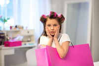 Little girl with pink shopping bag.