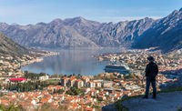 Tourist admiring the  landscape of the Bay of Kotor
